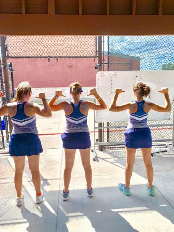 The girls stand in a ready stance as tennis season begins.