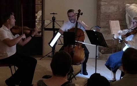 Dr. Kemptner performs with other musicians at Italian music event.