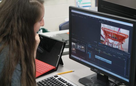 Senior Olivia Hoover edits her segment for the upcoming broadcast deadline.