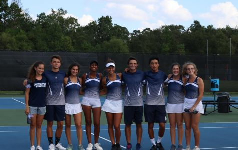 Members of the varsity tennis team pose for a picture after a successful tournament.