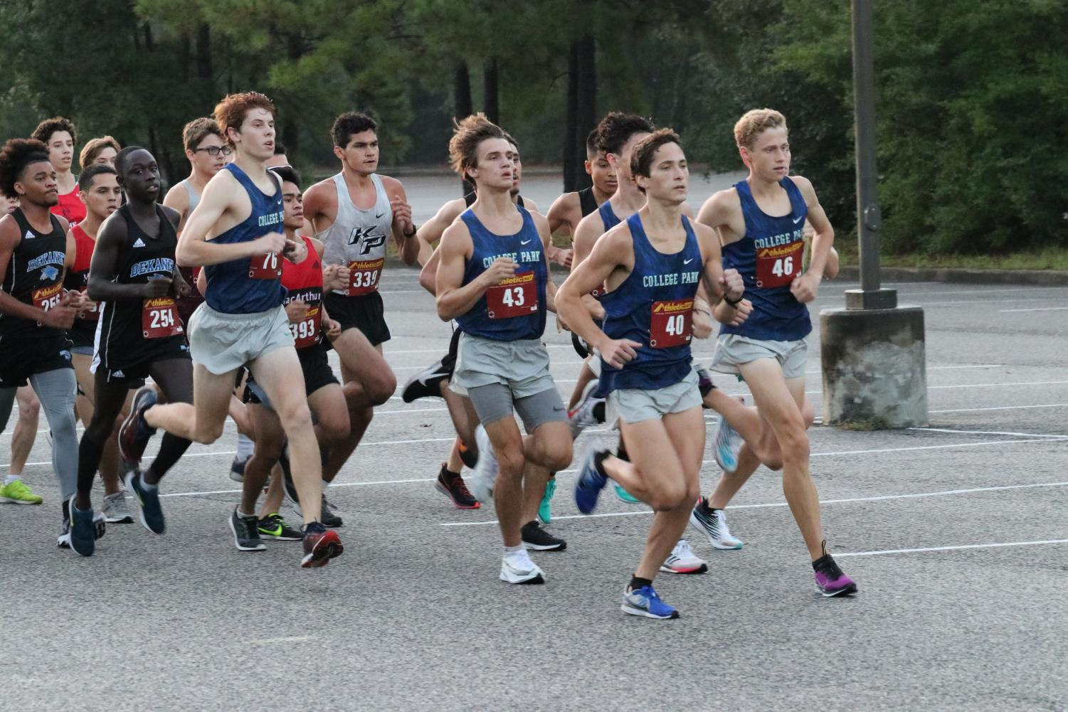 The CP runners take an early lead on their opponents during a meet.
