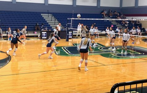 Diana Darvishi passes the ball to her teammate to complete the first set.