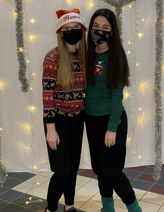 Revelier Officers, Caitlin Harwood and Emma Weixel at the Team's Holiday Party
