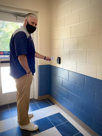 Christopher Garrison scanning with his pass to open the door.