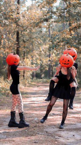 Ema Bavdaz, Catalina Garcia, and Ashley M. with pumpkin heads